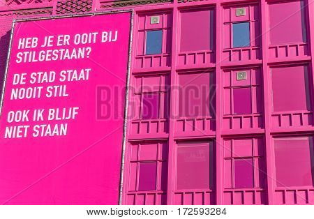 GRONINGEN, NETHERLANDS - FEBRUARY 15, 2017: Modern pink building with billboard in the center of Groningen, The Netherlands