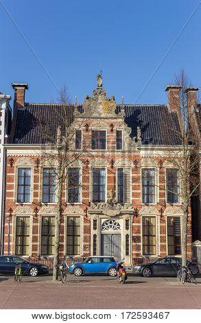 GRONINGEN, NETHERLANDS - FEBRUARY 15, 2017: Historical old building on the Ossenmarkt square in Groningen, Holland