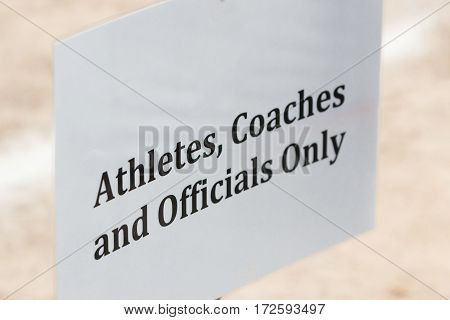 officials athletes and coaches authorized entry sign selective focus