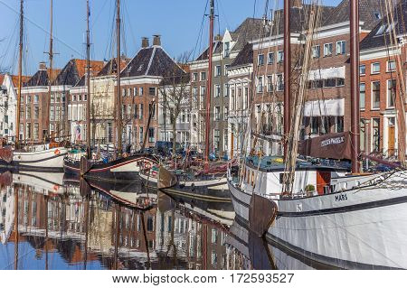 GRONINGEN, NETHERLANDS - FEBRUARY 15, 2017: Old ships and warehouses in the historical center of Groningen, Netherlands