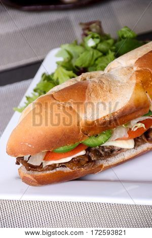 beef steak sub sandwich close-up on table  vertical