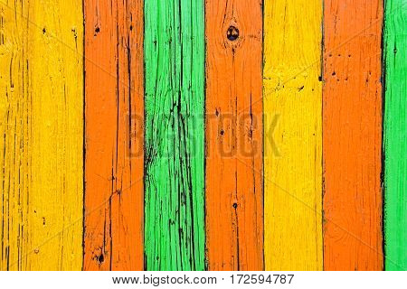 weathered old wood painted in bold colors