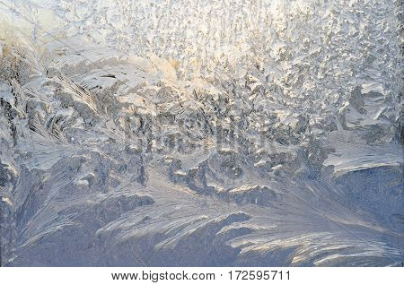 Variety of frost patterns on a winter window, frost