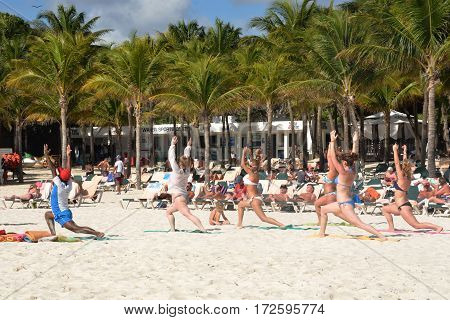 Playa del Carmen Mexico - January 28 2017: Keep fit exercise class on caribbean beach