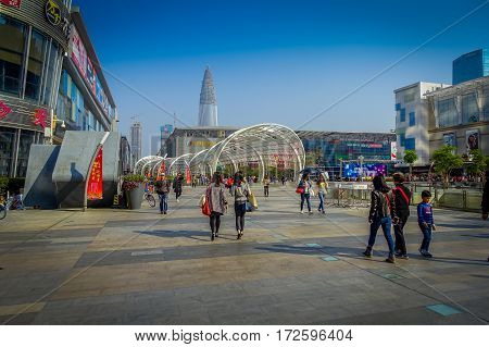 SHENZEN, CHINA - 29 JANUARY, 2017: Inner city streets and sorroundings of Nan Shan neighborhood, spectacular mix of green plants combined with modern buildings architecture, totally blue skies.