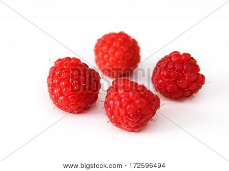 Berries ripe raspberry isolated on white background. Closeup.