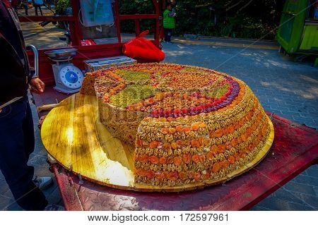 SHENZEN, CHINA - 29 JANUARY, 2017: Street vendor selling traditional arabic turron, sweet mixture of dried fruits and various nuts.