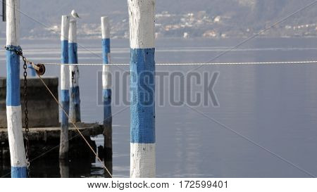 Colorful mooring poles in a lake harbor
