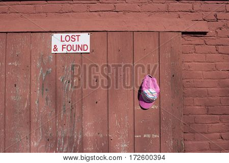 pink cap hanging on a hook at lost and found