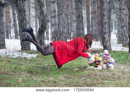 Young Woman Flying In The Forest With A Kettle.