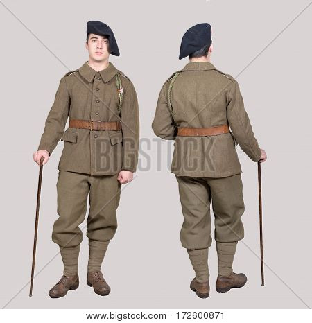 a french soldier in 1940's uniform front and back view