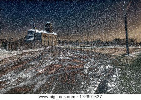 Snow covers the dirty road, a grass and roofs of houses. Church on a winter decline.