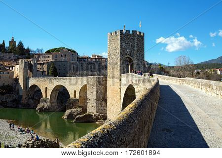 BESALU/ SPAIN - MARCH 28. Old romanesque fortress and bridge over the Fluvia river on March 28, 2015. Besalu, Spain.