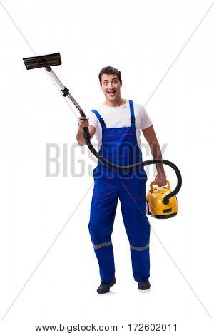 Man in coveralls doing vacuum cleaning on white