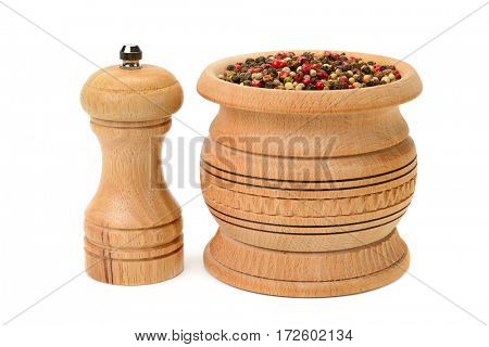 Different kinds of pepper and peppermill isolated on white background.
