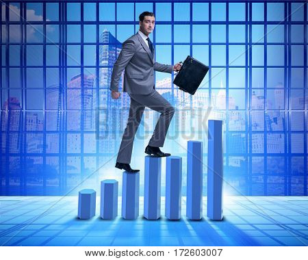 Businessman climbing bar charts in business concept