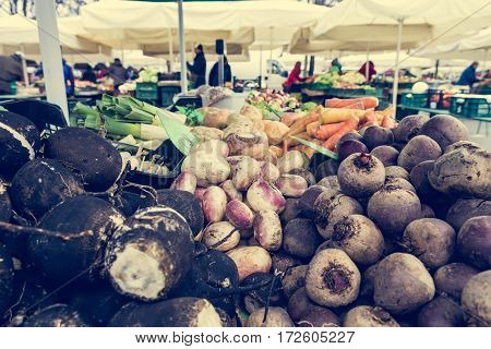 Closeup of beetroot at local outdoor market. Vegetables being sold.