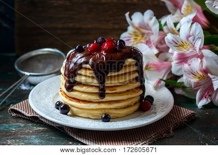 Pancakes With Berries And Chocolate Sauce