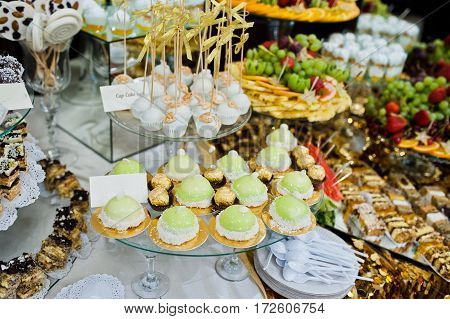 Differrent Cup Cakes At Wedding Reception Table.