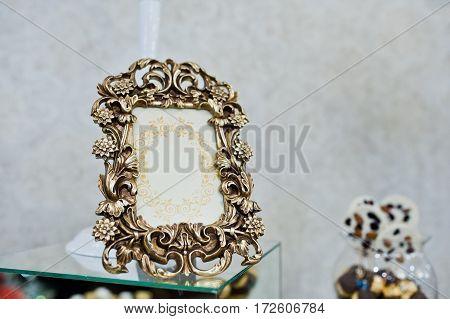 Bronze Vintage Frame Of Decor At Wedding Reception.