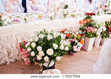 Bouquets Of Different Flowers At Wedding Reception.