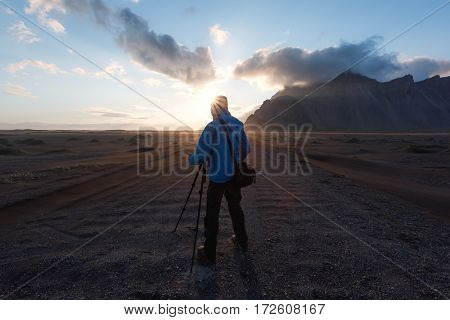 Photographer near famous Stokksnes mountains, Iceland