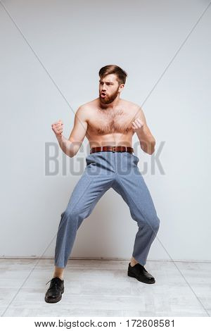 Vertical image of Male nerd as fighter with naked torso