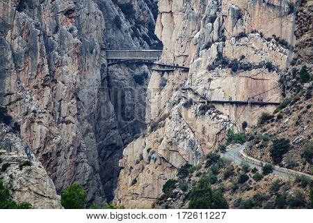Caminito del rey antique bridge with tourists, very long shot, vintage view