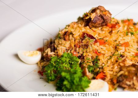 appetizing meat pilaf with herbs and eggs