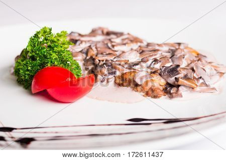 mushrooms with a tomato and herbs sauce