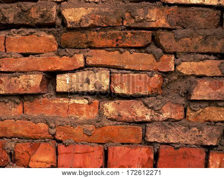 Old red brick wall textured sloppy brickwork