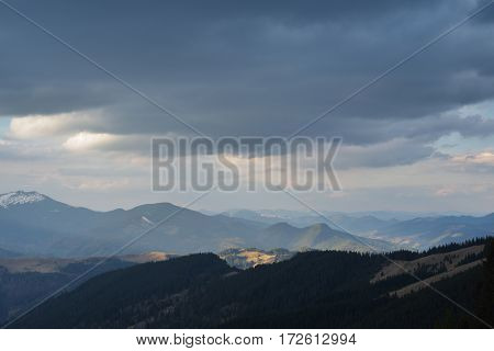 Mountain landscape in the spring. Cloudy sky overcast day. Carpathians, Ukraine, Europe. Flip image horizontally