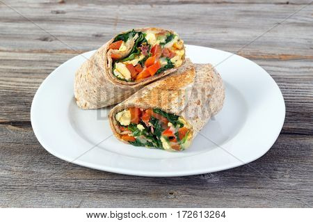 egg and spinash lunch wrap sandwich on table