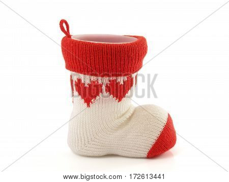 pen holder made of knitted sock and axis is a plastic cup isolated on white background, stationery storage devices handmade craft