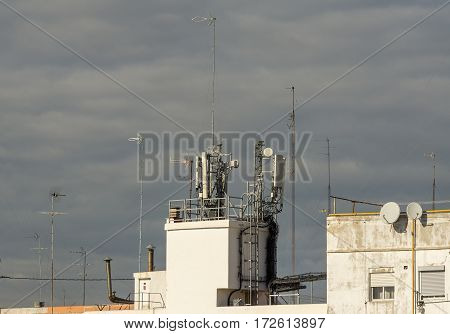 Mobile antennas on residential building. Dangerous, carcinogenic, harmful to health