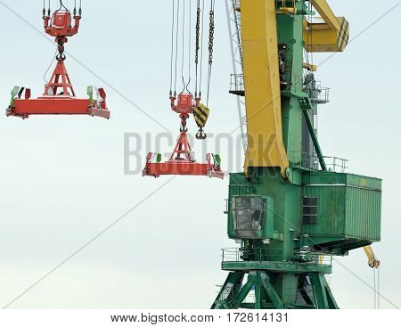 Cargo crane in the port is used for loading tankers.