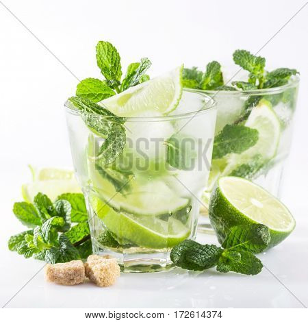 drink with fresh lime and mint on a white background