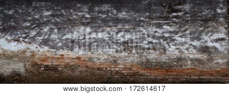 Background Broken Wall With Dirty Plaster And Old Brick.