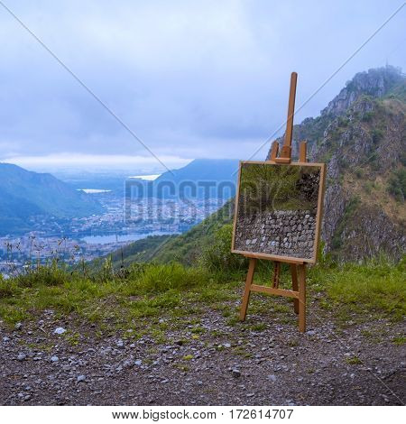Easel in the highlands overlooking the city in the cloudy day