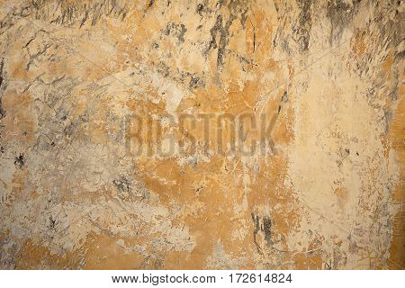 Background broken dirty old wall of painted glossy plaster. Blank vintage surface texture. Design pattern of loft grunge surface.