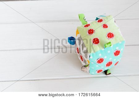 handmade toy dice pillow on white background with copy space