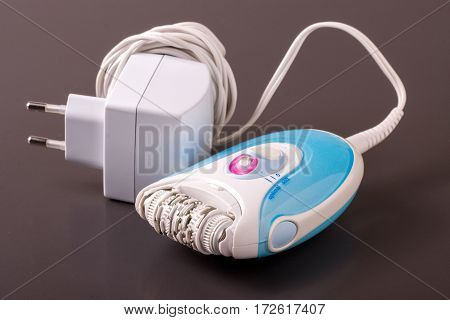 electric epilator or depilator hair on a dark background. Hair removal device