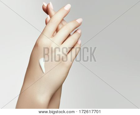 Woman Hand With Cream. Closeup Portrait Of Beautiful Happy Girl With Nude Makeup And Natural Manicur