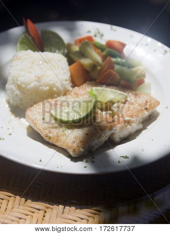 fresh fish fillet with garlic lime rice and Central American vegetables as photographed in Big Corn Island Nicaragua