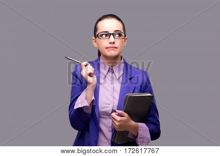 Puzzled businesswoman on gray background
