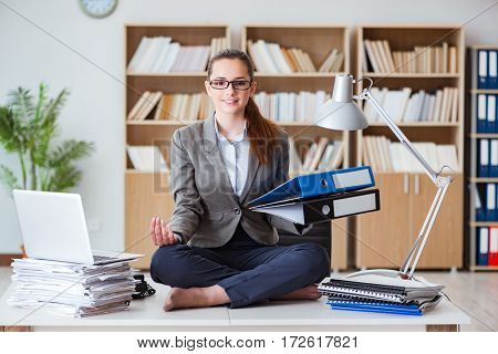Businesswoman meditating in the office