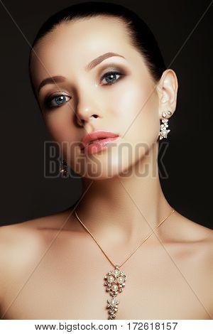 Portrait Of Beautiful Brunette Woman. Fashion Portrait Of Beautiful Luxury Woman With Jewelry. Magni