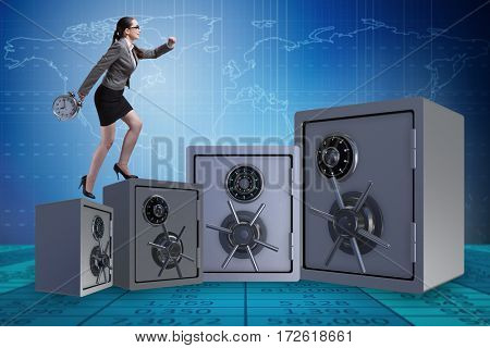 Businesswoman walking on top of safe