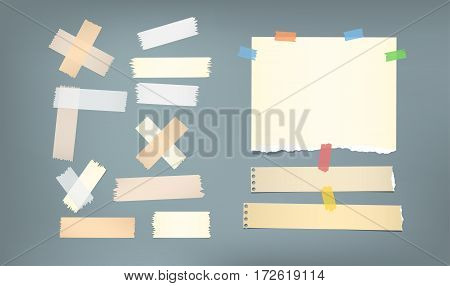 Ripped brown notebook, copybook, note paper strips, sticky, adhesive masking tape stuck on gray background.