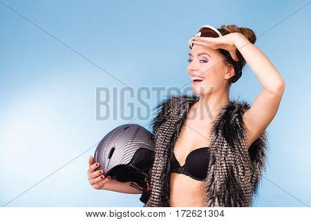 Woman Wearing Bra, Holding Ski Helmet, Looking Up